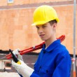 Apprentice / trainee. construction worker on building site — Stock Photo