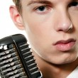 Young singer with retro mic - Stock Photo