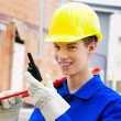 Stock Photo: Apprentice / trainee. construction worker on building site