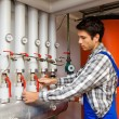 Stock Photo: Heating engineer in boiler room