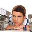 Stress in the pile of files with doctor - Stock Photo
