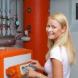 Woman in the boiler room for heating — Stock Photo #8188569