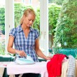 Housewife ironing with irons — Stock Photo #8188574