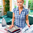Housewife ironing with irons — Stock Photo