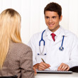 Medical consultation. patient and doctor talking — Stock Photo