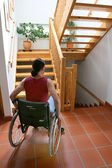 Handicapped woman in wheelchair — Stock Photo