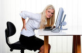Woman with pain in the back office — Stock Photo