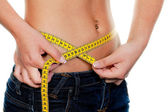Slim woman with measuring tape measure her figure — Stock Photo