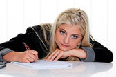 Woman with paper and pen to write — Stock Photo