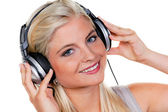 Woman with headphones listening to music — Stock Photo