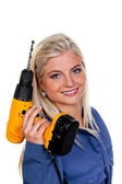 Woman in blue work clothes with drill — Stock Photo