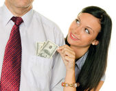 Woman pulls a man out of his pocket money, — Stock Photo