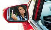 Angry woman driving the car when — Stock Photo