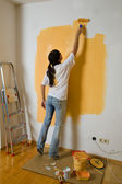 Woman colours her first flat — Stock Photo