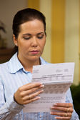 A woman with unpaid bills — Stock Photo