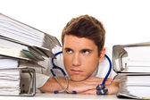 Stress in the pile of files with doctor — Stockfoto