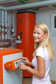 Woman in the boiler room for heating — Stock Photo