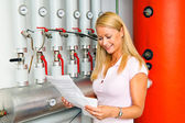 Woman in the boiler room for heating. — Stock Photo