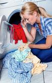 Housewife with washing machine — Stock Photo