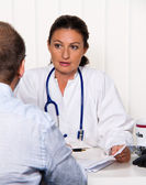 Physician in practice with patients. — Stock Photo