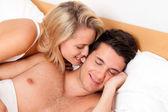 Couple has fun in bed — Stock Photo