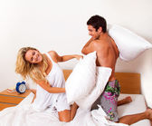 Couple has fun in bed. — Stock Photo