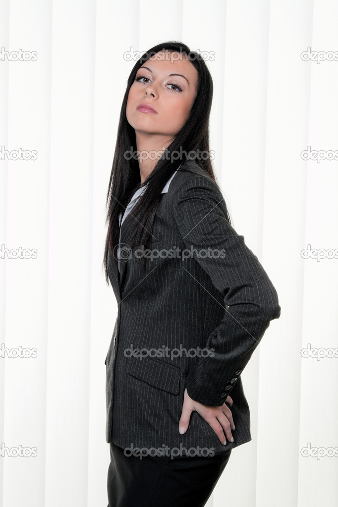 Confident business woman business outfit with an arrogant look — Stock Photo #8182613