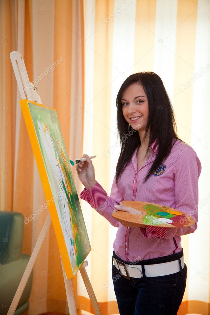 Young girl painting on an easel — Stock Photo ...