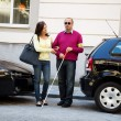 Woman helps blind man on the street — Stock Photo #8190256