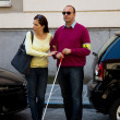 Woman helps blind man on the street — Stock Photo