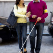 Stock Photo: Womhelps blind man