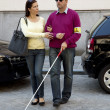 Woman helps blind man — Stock Photo