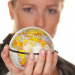 Women with a globe in his hand — Stock Photo #8190820