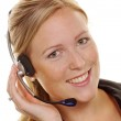 Woman with headset in customer service — Stock Photo