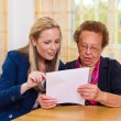 Grandson and grandmother. contract, will — Stock Photo