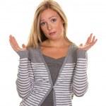 Unsuspecting woman shrugs — Stock Photo #8191025
