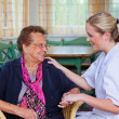 Home care of old lady - Stock Photo