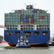 Cargo ship with containers at the port of hamburg - Stock Photo