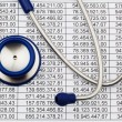 Balance sheet figures and stethoscope — Stock Photo #8196303
