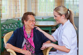 Home care of old lady — Stockfoto