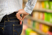 Shoplifting in a supermarket — Stock Photo