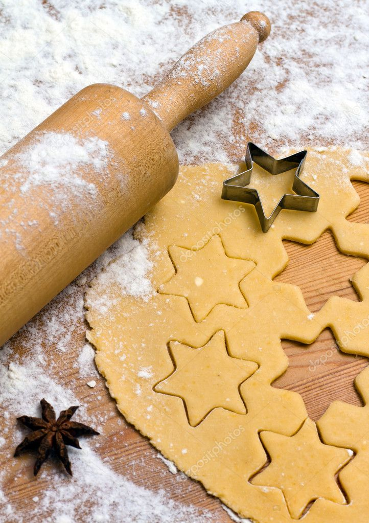 Baking cookies and biscuits in advent. preparing for christmas — Foto de Stock   #8196171
