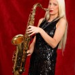 Young pretty woman playing saxophone — Stock Photo