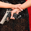 Royalty-Free Stock Photo: Woman in evening dress with concealed weapon