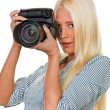 Young girls with a digital camera - Stock Photo