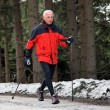 Senior nordic walking in winter — Stock Photo