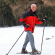 Stock Photo: Senior when snowshoeing in winter