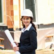 Architect with plan on construction site — Stock Photo #8267101
