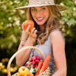 Stock Photo: Womwith fruit and vegetables from garden