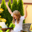 Stock Photo: Successful, smiling womwith laptop in garden